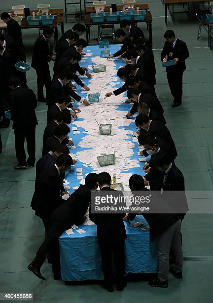 Election staff members count votes in Parliament's lower house elections at a ballot counting center on December 14 2014 in Himeji Japan Japan Prime...