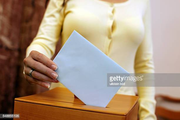 election woman at the ballot box