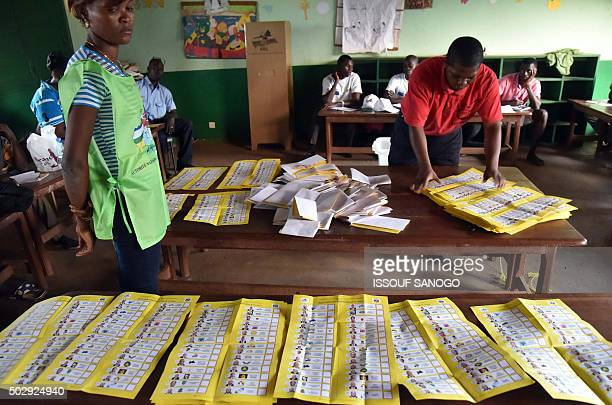 Election workers count votes after polls closed during the presidential and legislatives elections in Bangui's city center on December 30 2015 Voters...