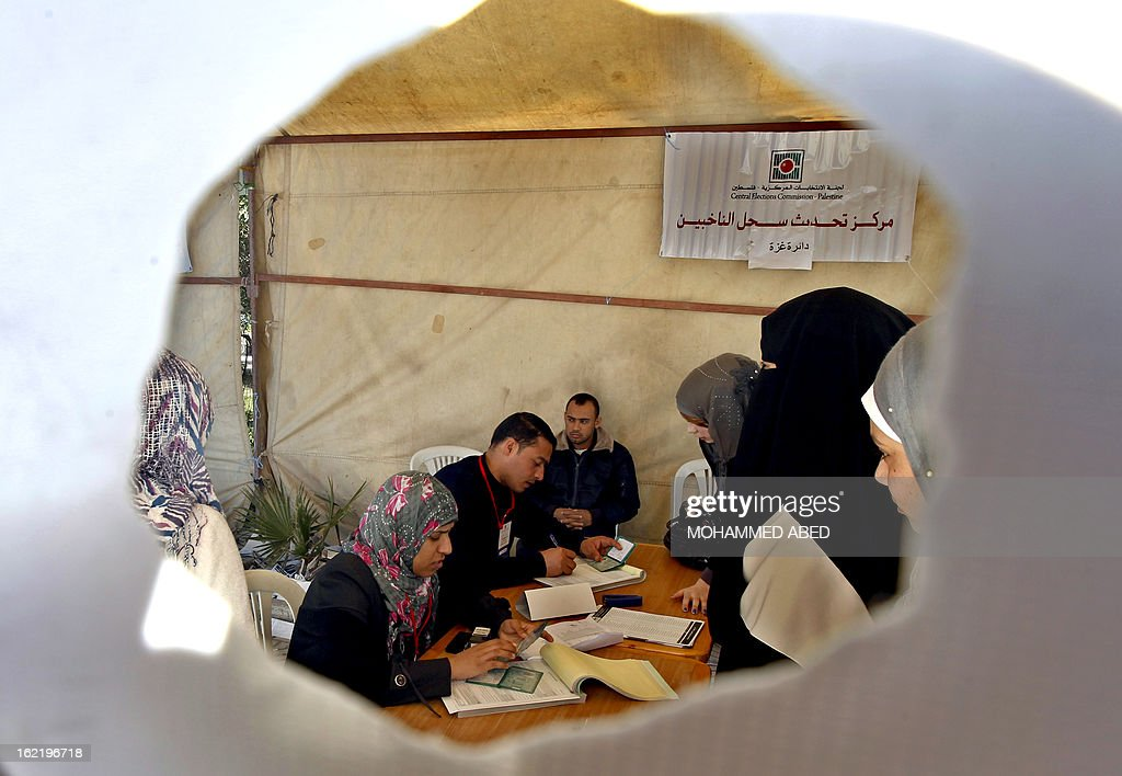 Electoral commission officials register Palestinians at a registration tent set-up along a street in Gaza City on February 20, 2013. Palestinian electoral officials are updating voter rolls in the West Bank and Gaza in a vital step towards eventual elections.