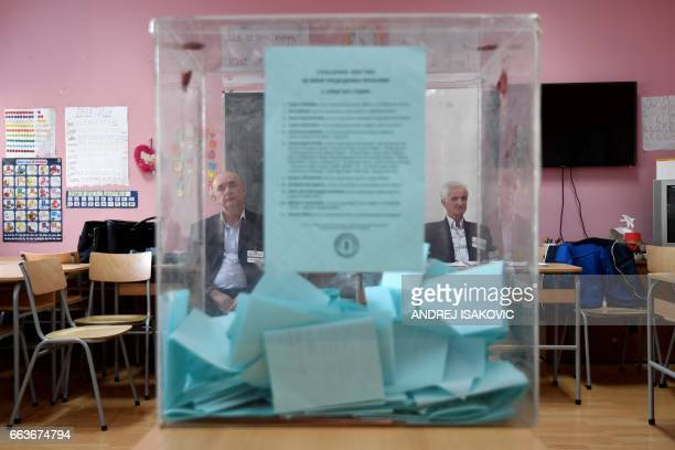 TOPSHOT Electoral committee members sit at a polling station in Belgrade on April 2 2017 Serbians head to the polls to elect a new president with...