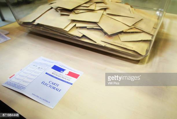 Electoral letter and votes in the 18th district of Paris as French voters go to the polls to vote in the second round of the French Presidential...