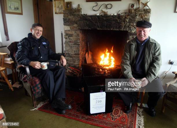 Electoral officer Hugh O'Donnell with Garda Brendan McCann take a break before carrying the ballot box to another cottage for the Lisbon Treaty...