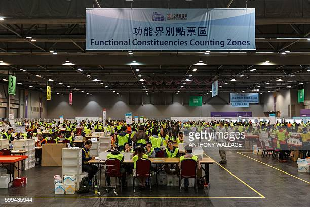 Electoral officials count votes that were cast for the Legislative Council election at the central counting station in Hong Kong on September 5 2016...