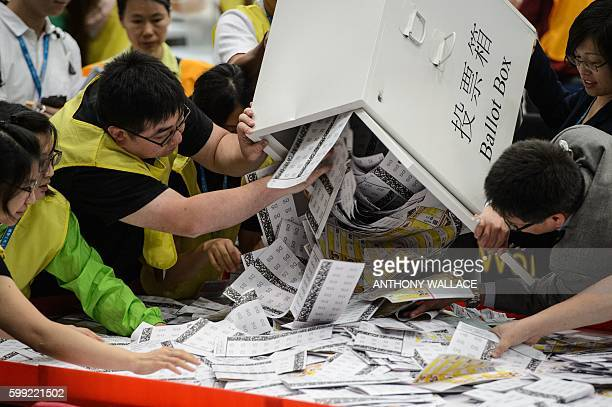 Electoral officials empty a ballot box for counting after voting stations closed for the Legislative Council election in Hong Kong early on September...