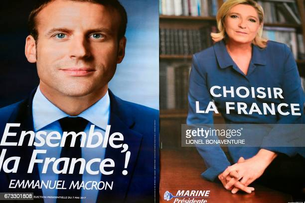 Electoral posters of French presidential election candidate for the En Marche movement Emmanuel Macron and French presidential election candidate for...