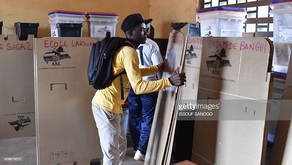 Electoral workers check voting material that will be used in the Central African Republic second round presidential and legslatives elections, on Febuary 13, 2016, in Bangui, The Central African Republic holds delayed presidential and parliamentary polls on February 14, with voters desperate to usher in peace after the country's worst sectarian violence since independence in 1960. / AFP / ISSOUF SANOGO