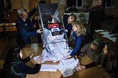 Electoral workers empty a ballot box to start counting ballots for the leadership vote in the selfdeclared Donetsk People's Republic and Lugansk...