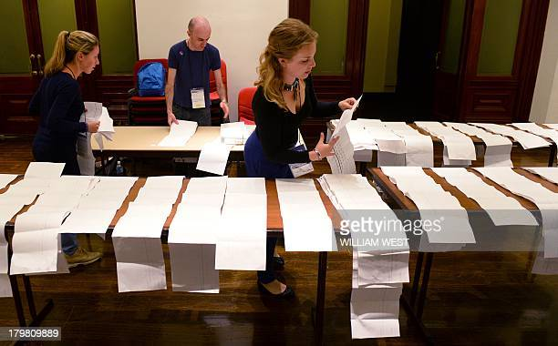 Electoral workers start counting the votes at Sydney's Town Hall on September 7 in Australia's general election Early results show conservative...