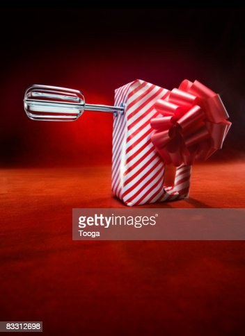Electric beaters wrapped in gift paper
