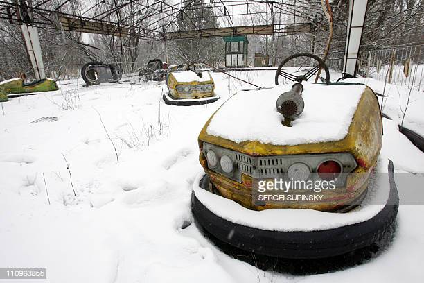 Electric bumpers cars are left behind in an amusement park in the ghost town of Pripyat near Chernobyl's nuclear power plant 27 February 2006...