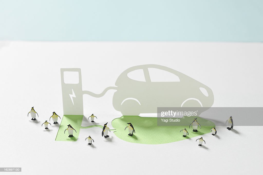 Electric car and electric stand : Stock Photo