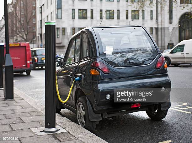 electric car being charged in city street