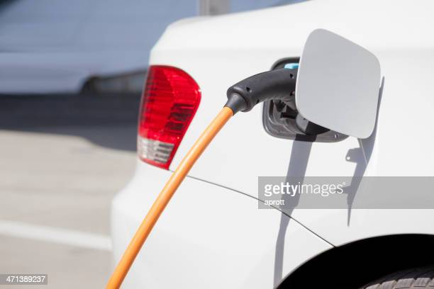 Electric car being charged.
