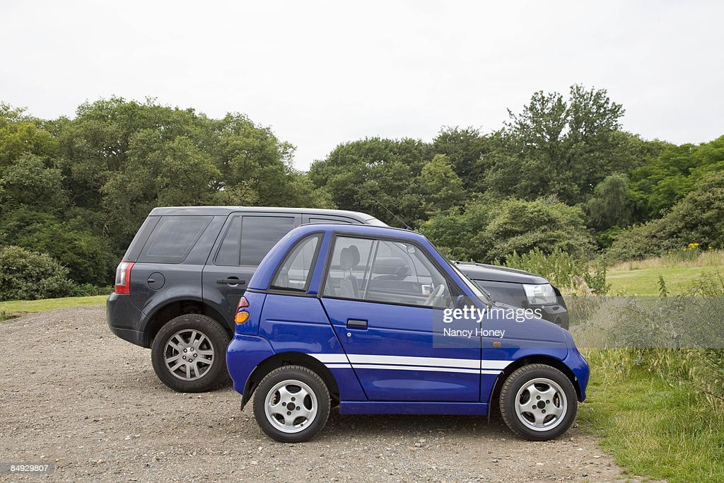Electric car next to four wheel drive