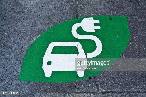 Electric car sign, charging station, green sign painted on street