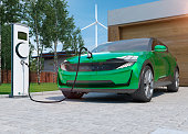 electric car SUV charging at home in front of modern low energy suburban house