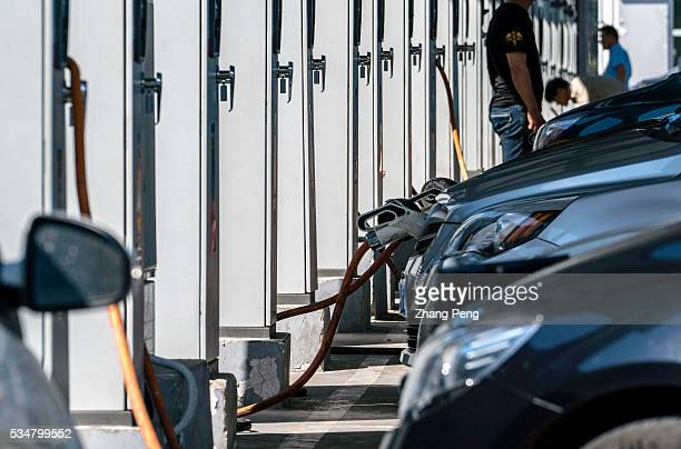 Electric cars are charging in a electric charging station The electric car market in China is heating up thanks to generous government incentives and...