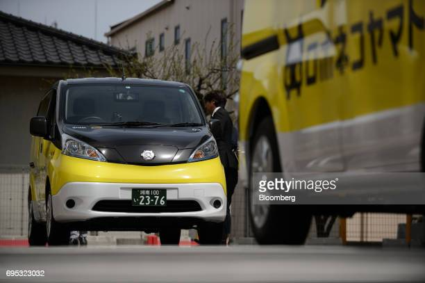Electric cars for Robonekoyamato autonomous van delivery service operated by Yamato Transport Co and DeNA Co stand in Fujisawa City Kanagawa...