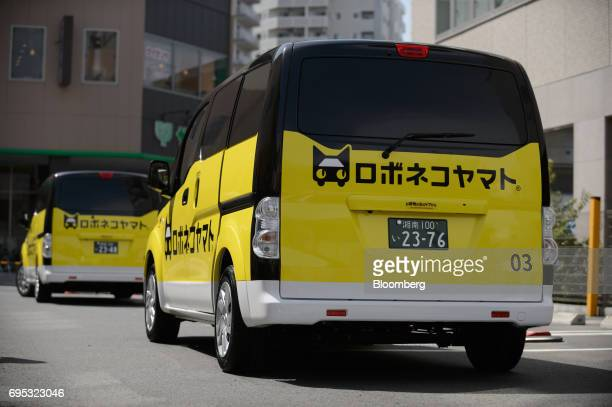 Electric cars for the Robonekoyamato autonomous van delivery service operated by Yamato Transport Co and DeNA Co stand in Fujisawa City Kanagawa...