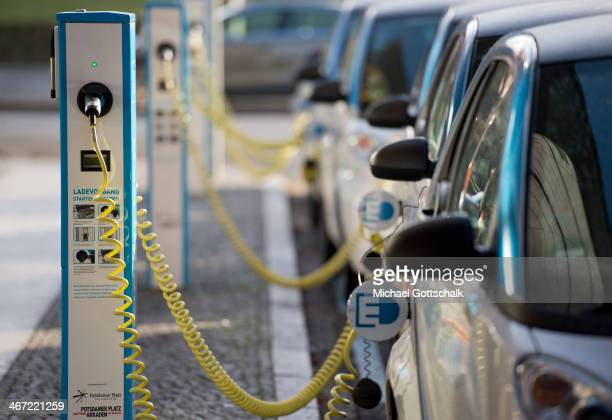 Electric Cars of the type Smart recharge at a charging station on February 06 2014 in Berlin Germany The number of electric cars has risen in Germany