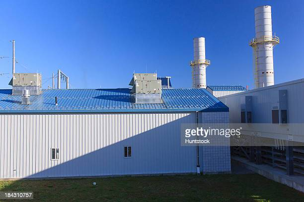 Electric cogeneration plant facility with exhaust stacks