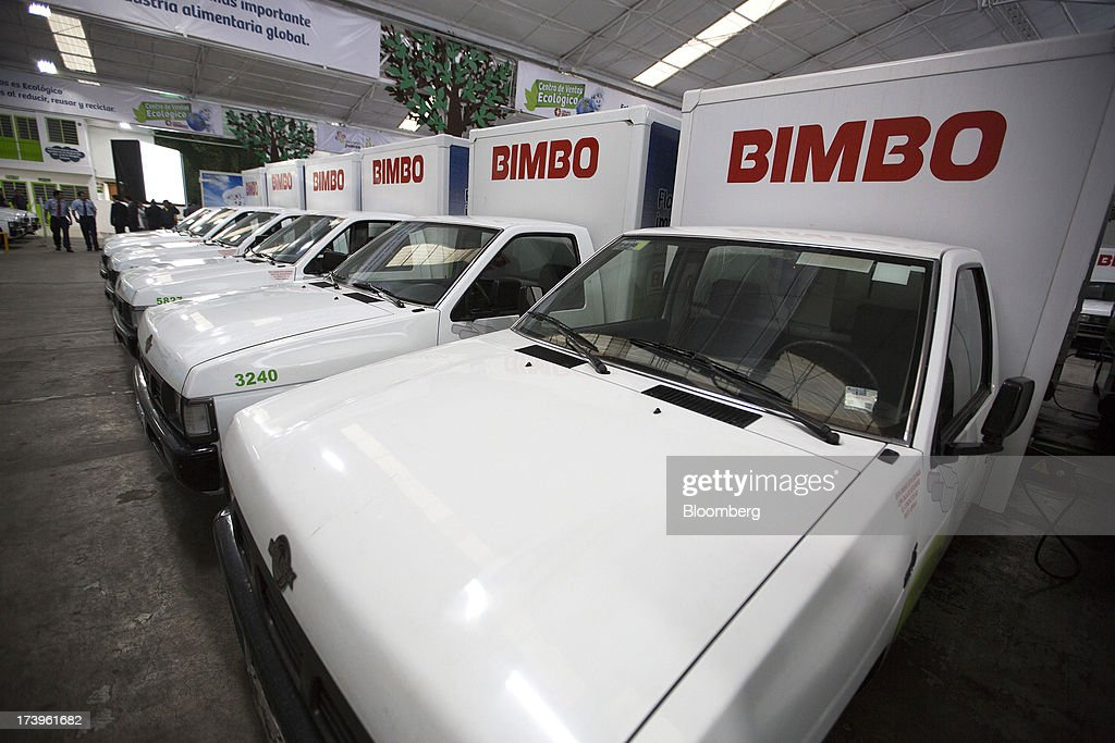 Electric delivery trucks sit inside Grupo Bimbo SAB de CV's new sales center in Mexico City, Mexico, on Thursday, July 18, 2013. Grupo Bimbo inaugurated a new eco-friendly sales center today. Photographer: Susana Gonzalez/Bloomberg via Getty Images