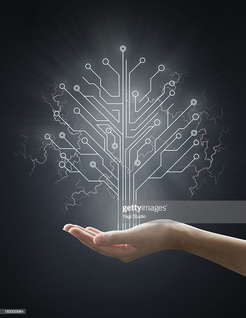 Electric energy sparks from a hand ,form of  tree : Stock Photo
