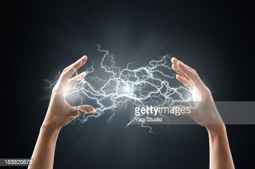 Electric energy sparks from a hand