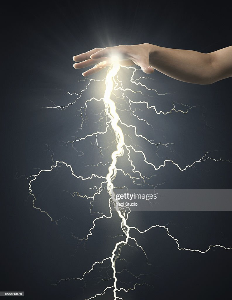 Electric energy sparks from a hand : Stock Photo
