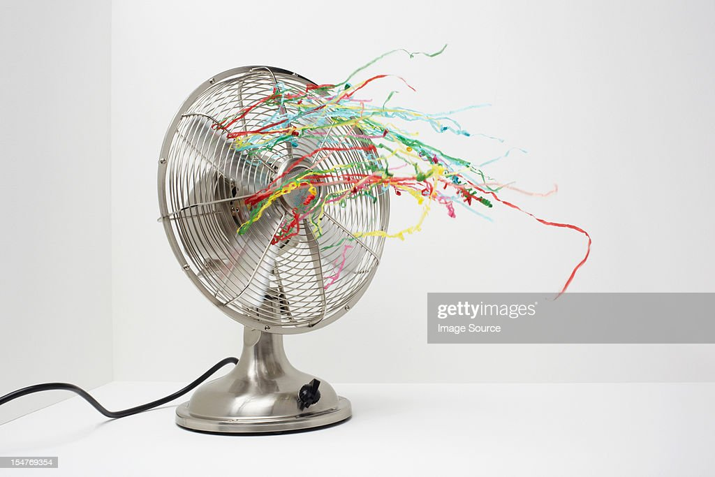 People Using Electric Fan : Electric fan with streamers stock photo getty images