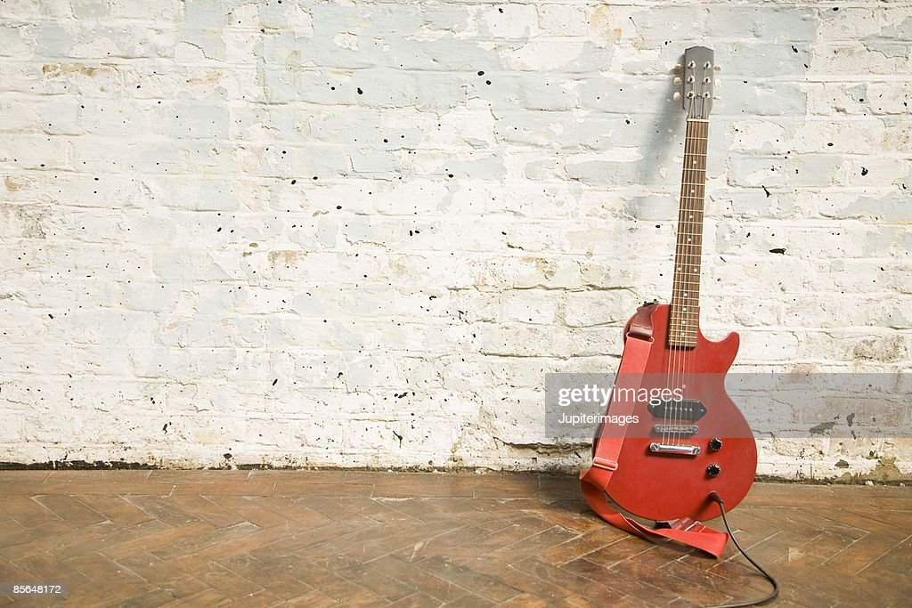 Electric guitar against brick wall