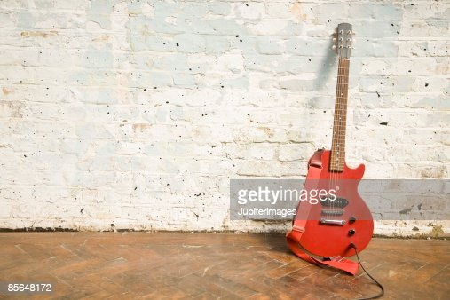 Electric guitar against brick wall