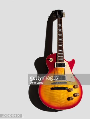 Electric guitar against white background, close-up