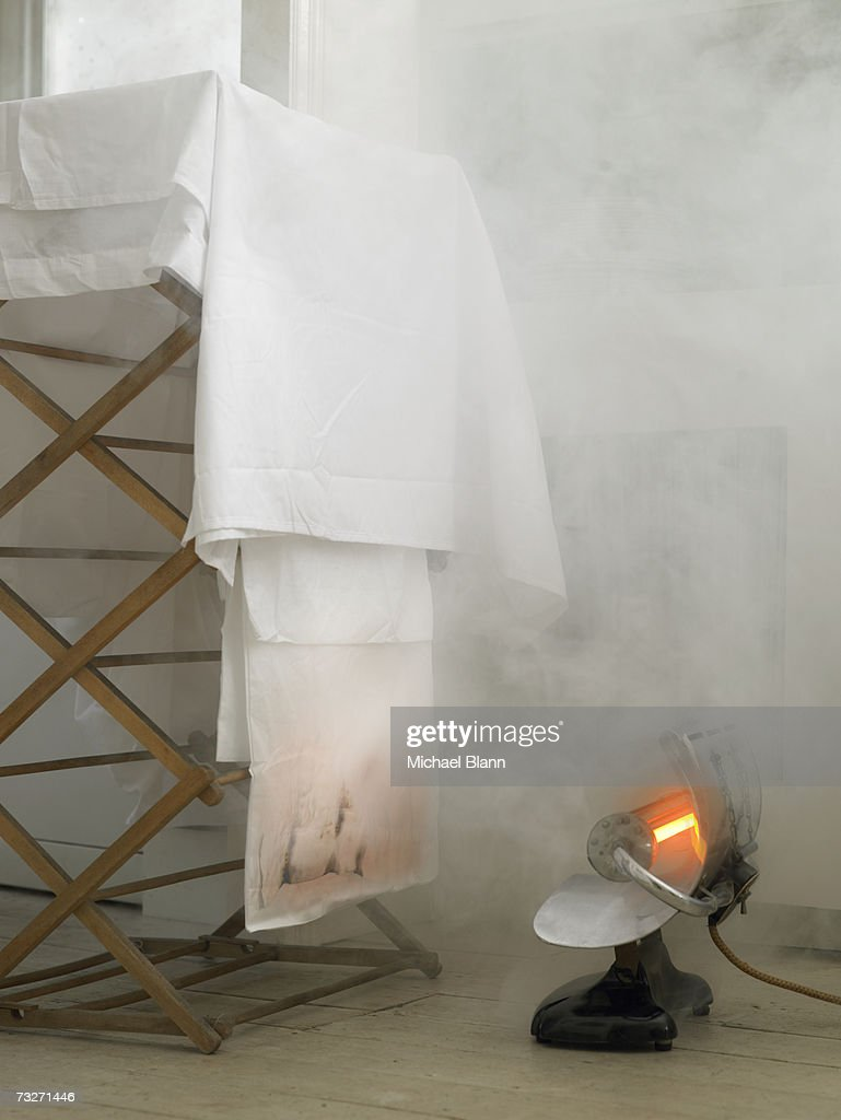 Electric heater starting fire : Stock Photo