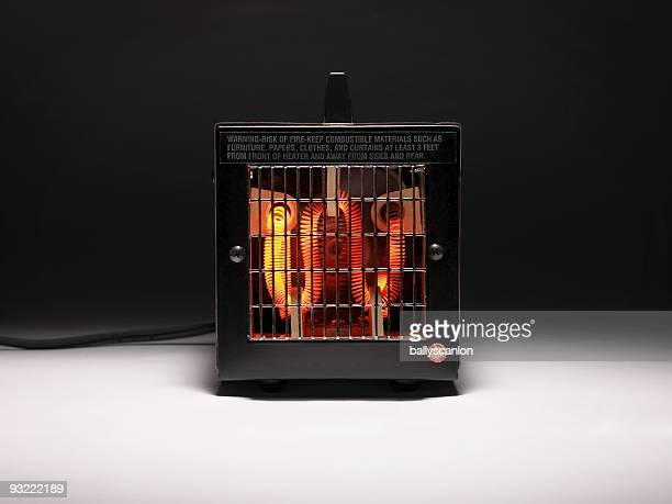 Electric heater with combustible warning.