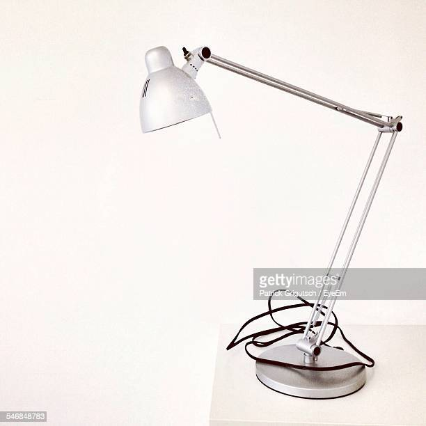 Electric Lamp On Table Against White Background