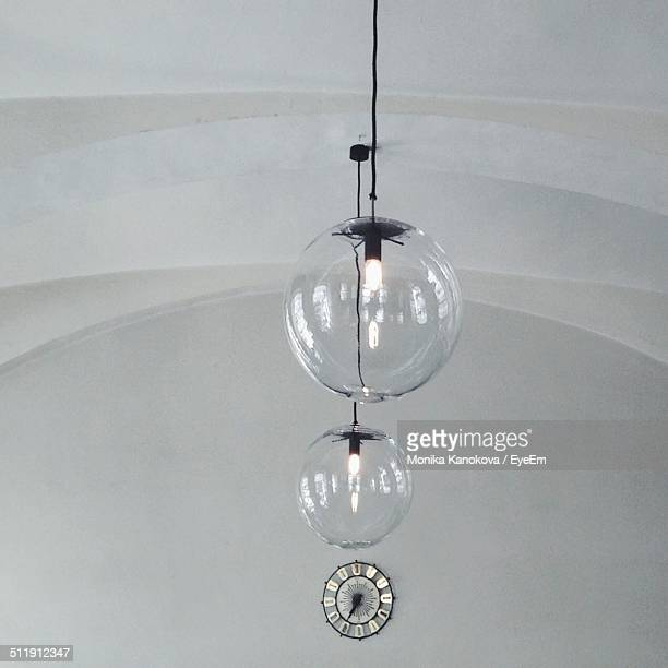 Electric lights hanging from ceiling