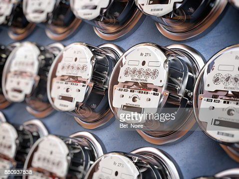 Electric meters in a row measuring power use. Electricity consumption concept. : Stock Photo