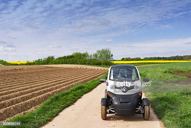 Electric Renault Twizy 45 driving on  rural road in Belgium