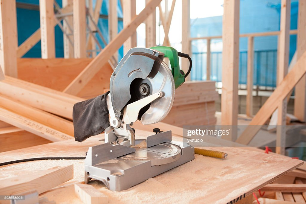 Electric saws placed in a residential construction site. : Stock Photo