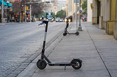 Electric Scooter on Sidewalk in Downtown District