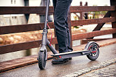 Use of scooter as a means of transportation on the street.