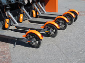 City bike rental system, public kick scooters on the street