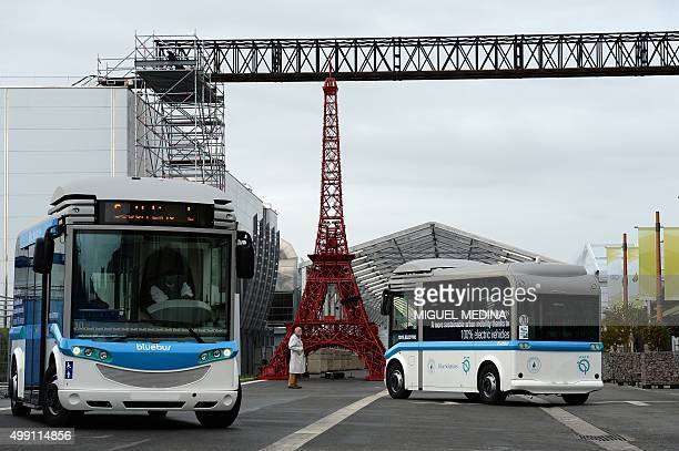 Electric shuttles drive past an Eiffel tower made with Bistro chairs at the venue of the United Nations Conference on Climate Change or COP21 in Le...