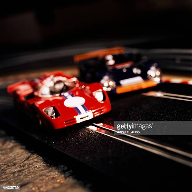 Electric slot cars, close-up (focus on red car)