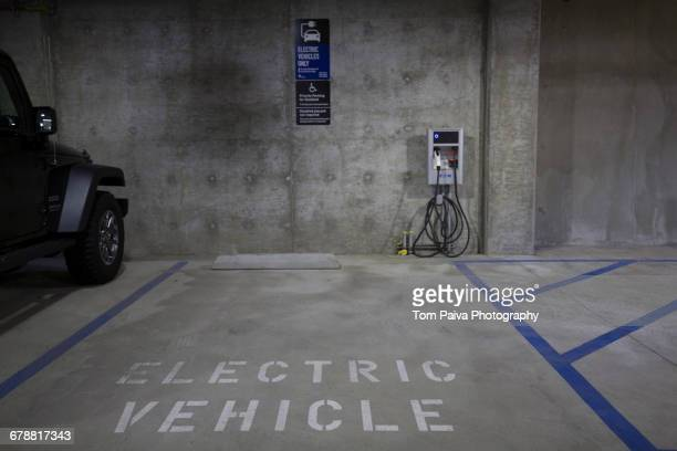 Electric vehicle parking space and charging station