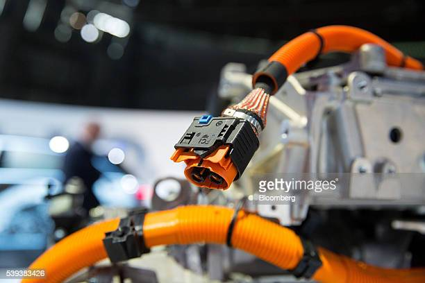 Electrical cables hang from an automobile engine during Daimler AG's TecDay Road to the Future event in Stuttgart Germany on Thursday June 9 2016...