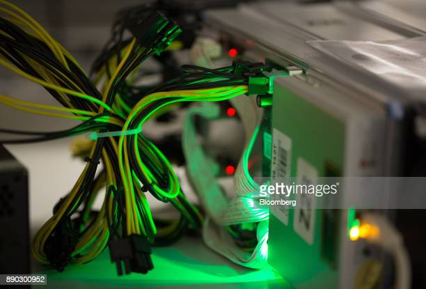 Electrical cabling connects to hardware devices used in cryptocurrency mining machine systems at the SberBit mining 'hotel' in Moscow Russia on...