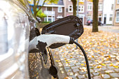 electrical care charging in an autumn cityscape